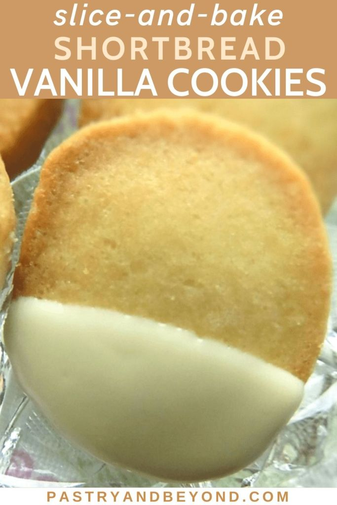 White chocolate dipped vanilla shortbread cookies in a glass plate.