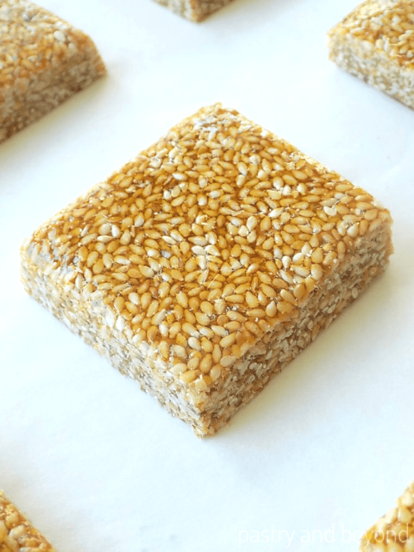 Overhead and side view of sesame bar on a white surface.