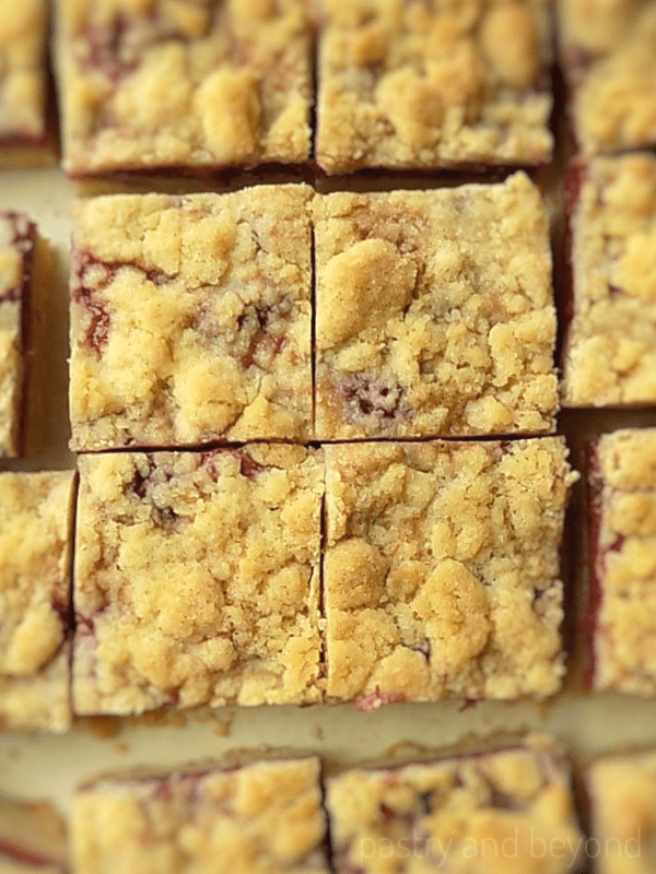 Overhead view of strawberry bars with crumble topping.