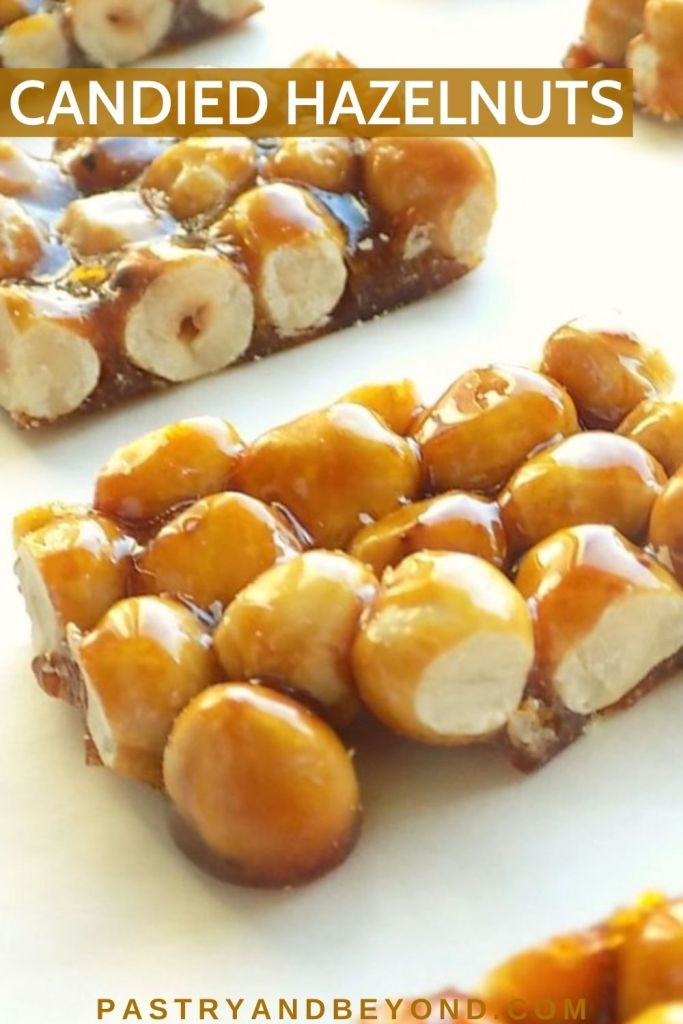 Candied hazelnut bars on a white surface.