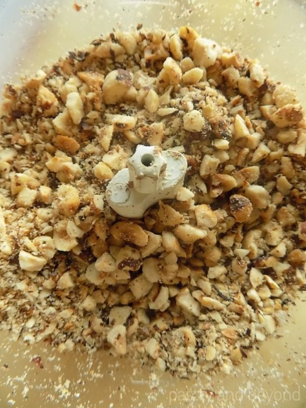 Hazelnuts chopped into big and small pieces