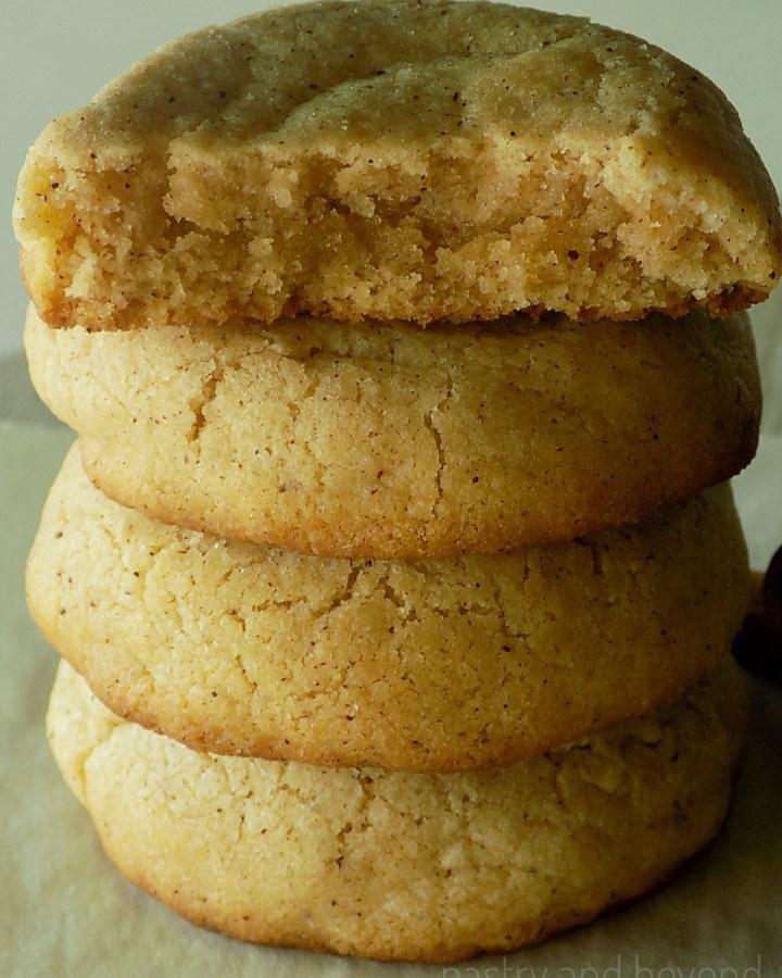 Stacked thick and soft cinnamon cookies.