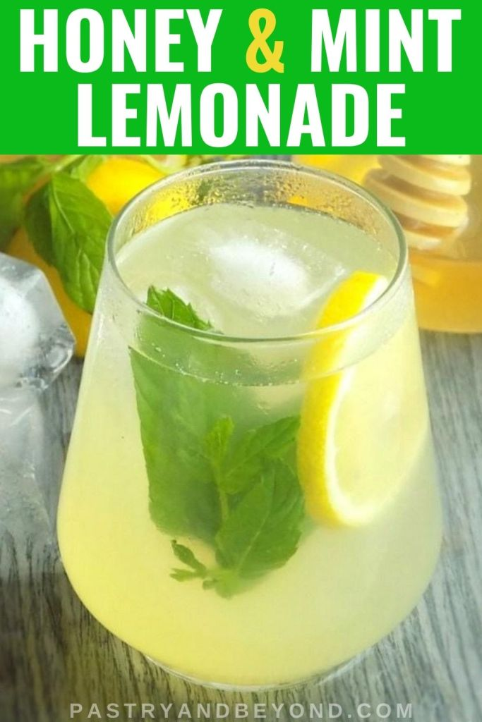 Lemonade in a glass with ice cubes, mint and a slice of lemon, with text overlay