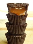 Stacked mini caramel chocolate cups.