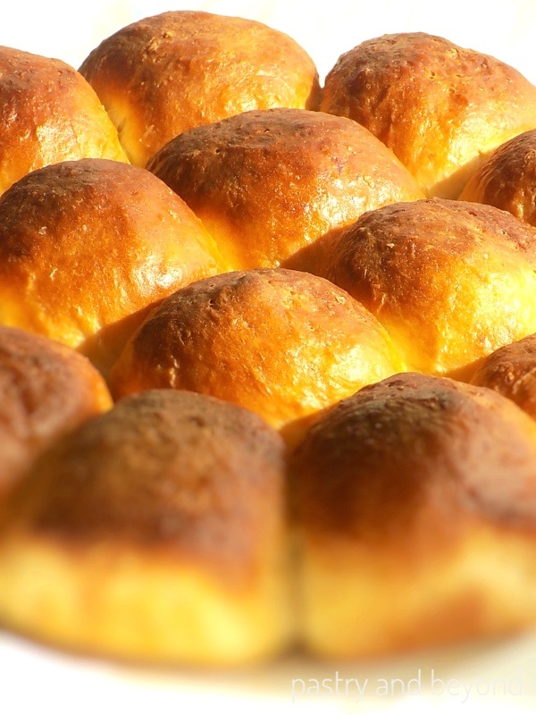 No knead soft dinner rolls after the top is brushed with melted butter.