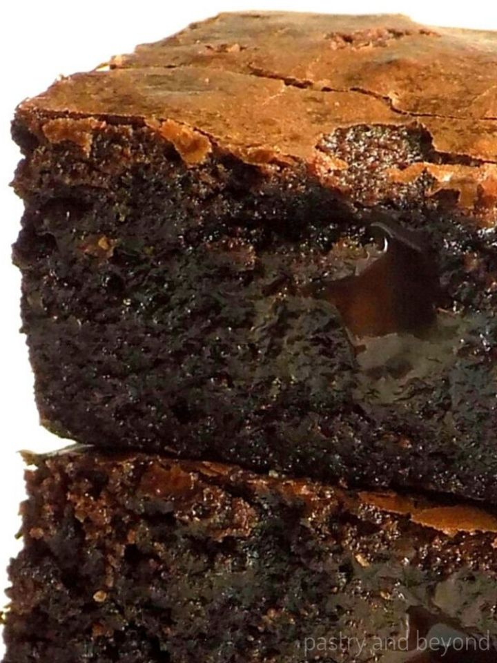 Stacked fudgy brownies without cocoa powder.