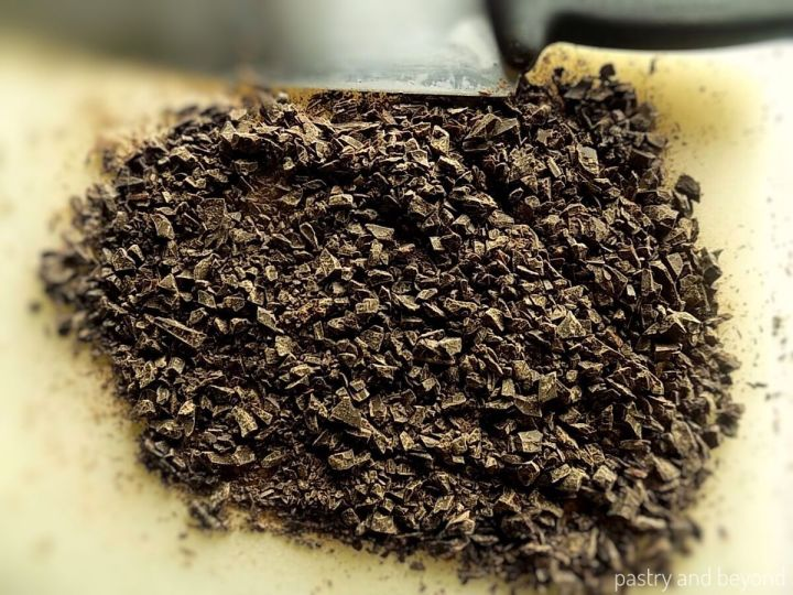 Chocolate chopped into small pieces to be used in a brownie recipe.