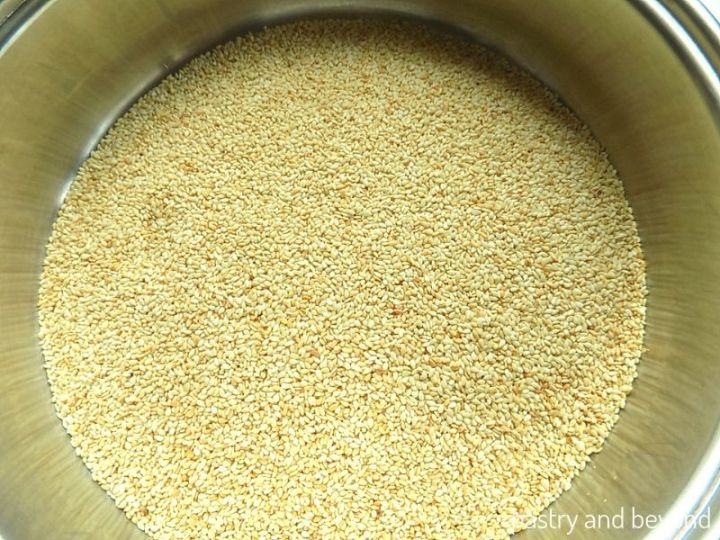 Lightly toasted sesame seeds in a pan.