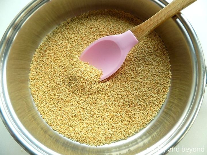 Toasting the sesame seeds in a pan.