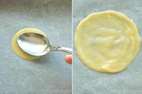 Spreading the Tuile batter on to the parchment paper with a small spoon.