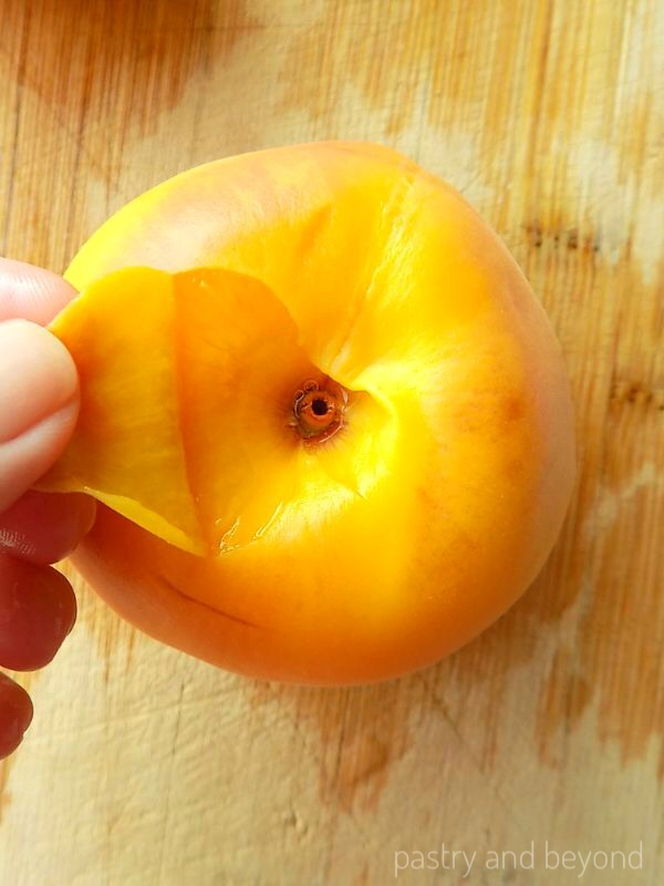 Peeling peaches after blanching the peaches