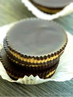 Stacked dark chocolate peanut butter cups.