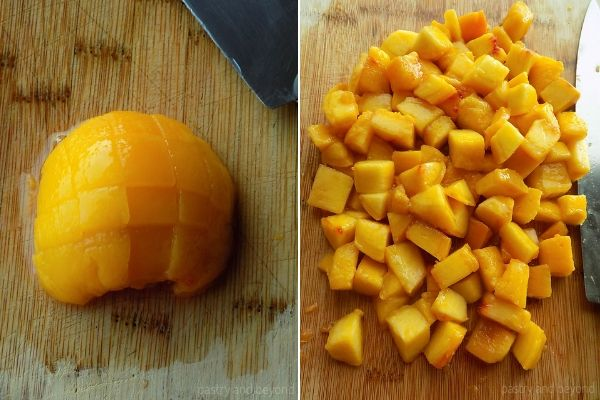 Chopping the peaches as cubes on a cutting board.