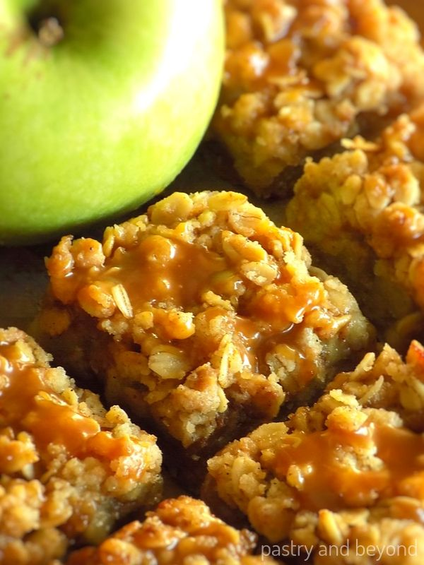 Caramel Apple Bars with green apple on the background.
