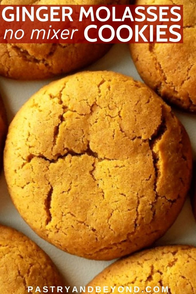 Ginger molasses cookies on a white surface.