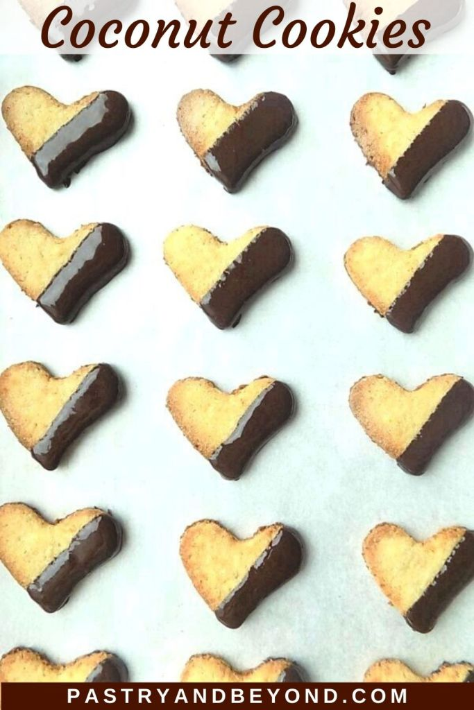 Coconut cookies on a parchment paper with text overlay.