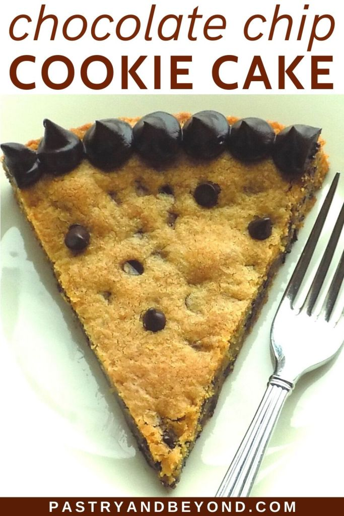 A slice of chocolate chip cookie cake on a plate.