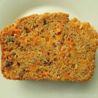 Carrot cake loaf slice on a white plate.