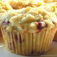 Lemon raspberry struesel muffins on a white surface.