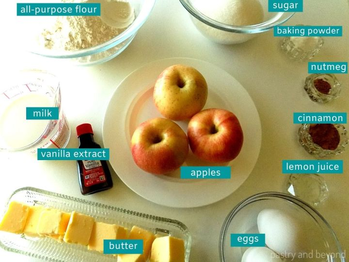Ingredients for apple crumble muffins on a white surface.