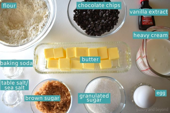 Ingredients for caramel chocolate chip cookie cups on a white surface.