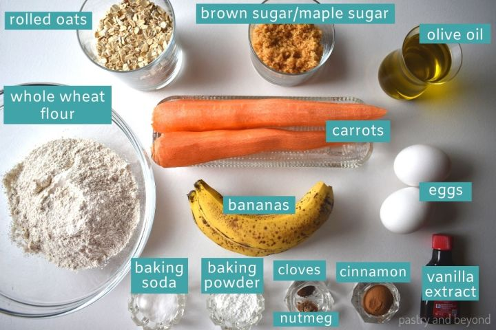 Banana carrot muffin ingredients on a white surface.