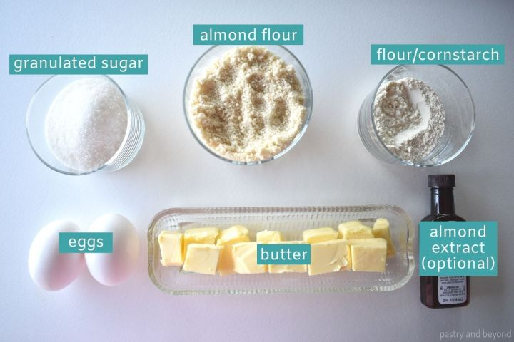 Ingredients of almond cream on a white surface.