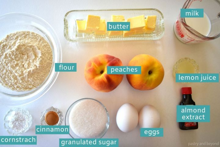 Ingredients for peach bread on a white surface.