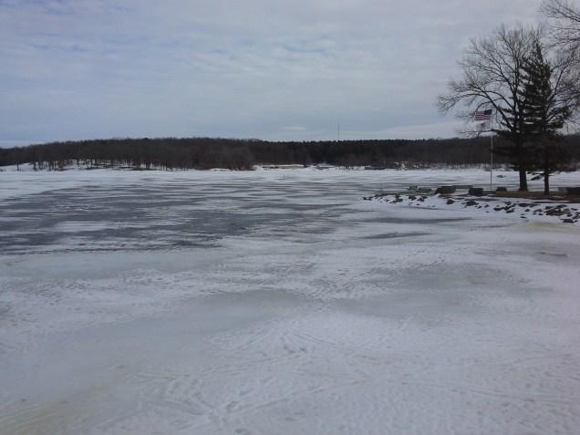 Looking across frozen lake