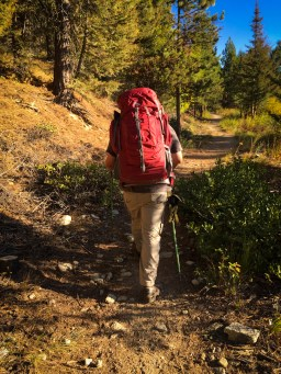 Mr. B Hiking along in his kelty coyote 80 with kelty trekking poles