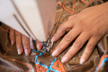 Ivonn Ena Paz Delgado demonstrates how she makes her complicated machine-stitched embroidery.