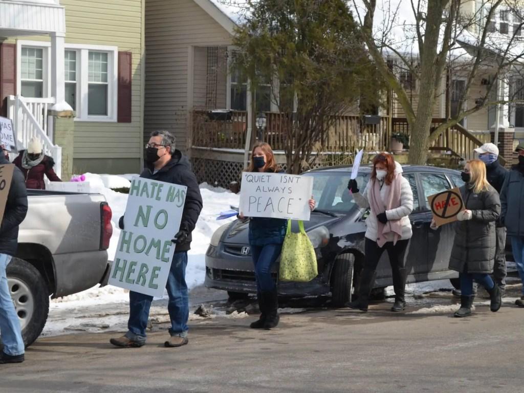 Whites, Blacks Push Back Against Hate In Detroit Suburb After KKK Flag Display