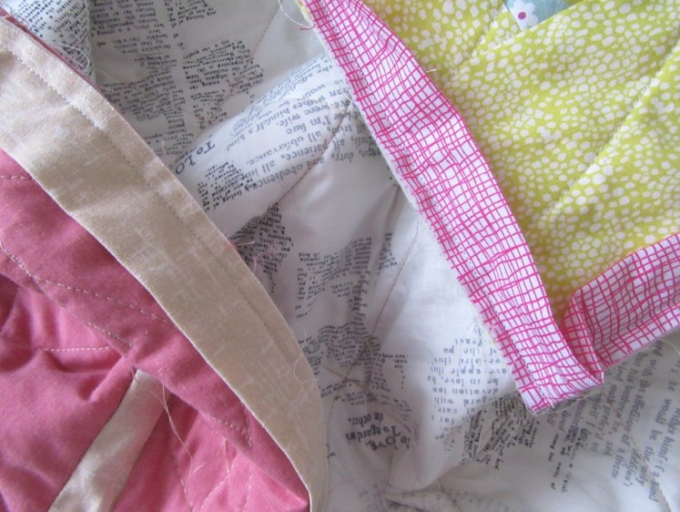 Two quilts needing binding to be stitched down