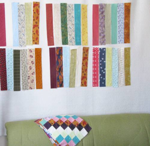 Scrappy Trip Along strips on my design wall by Allison Reid