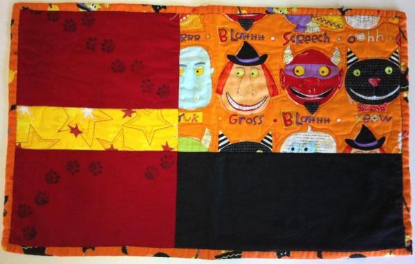Individual de patchwork Halloween naranja rojo negro