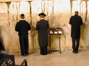 3 guys davening at the Kotel