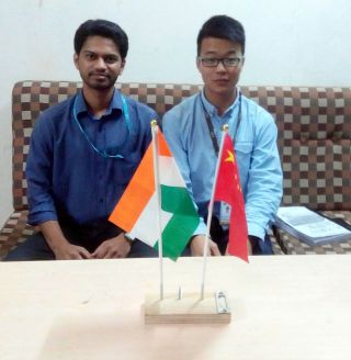 From Left: Nikhil Pathrabe, Mr. Zhou Hong Yu