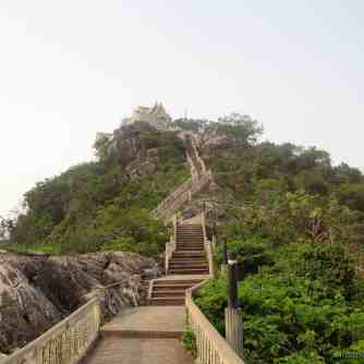 Forward Dominating the skyline of the humble provincial capital of Prachuap Khiri Khan, Thailand is this mountaintop temple. Visible from almost anywhere in the whole town, a series of wooden stairs lead forward . . .