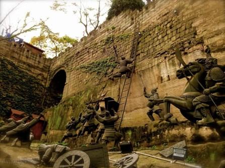 Statues reenacting a battle at the old Chongqing city wall.