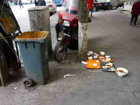 Used dishes on the sidewalk?