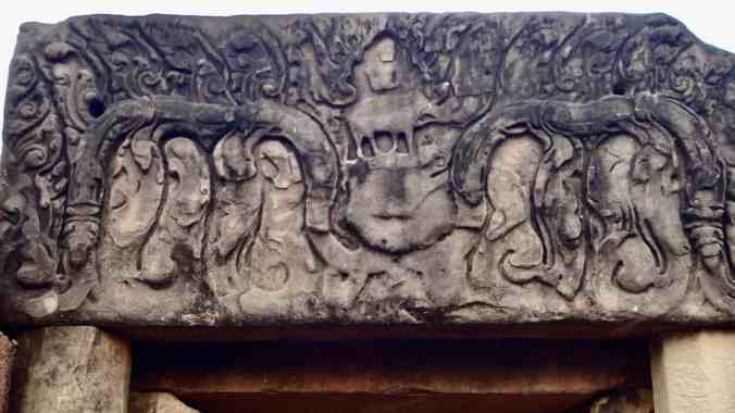 Lintel carving atop the entrance depicting Shiva and Nandi.