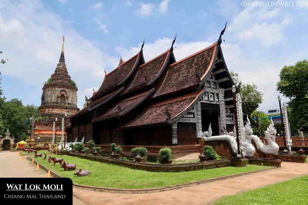 Wat Loki Moli exemplifies Lanna wood-carved temples and has an iconic giant ruined stupa.