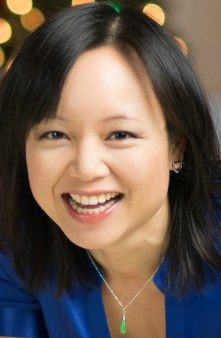 a headshot of beautiful Dr. Camille Nghiem-phu smiling, wearing a blue blouse with a jade pendant necklace