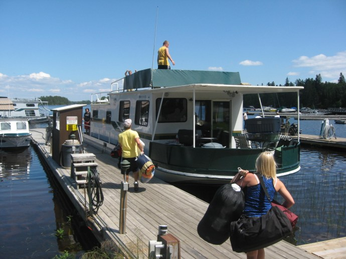 People bringing their gear on the houseboat