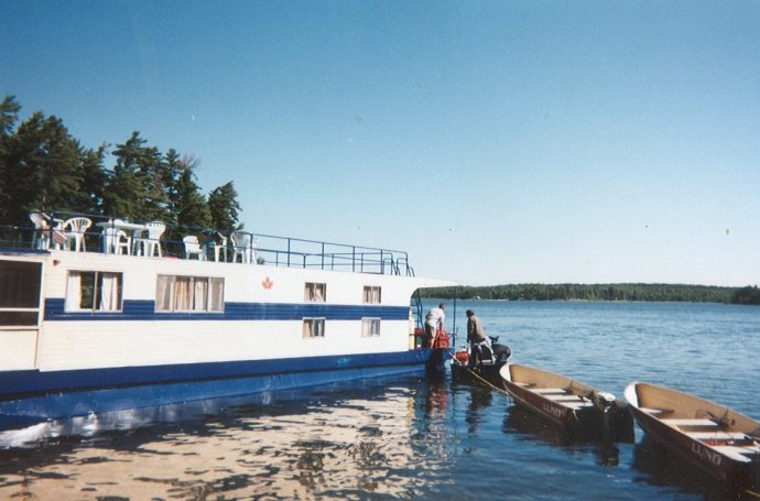 houseboat with row boats
