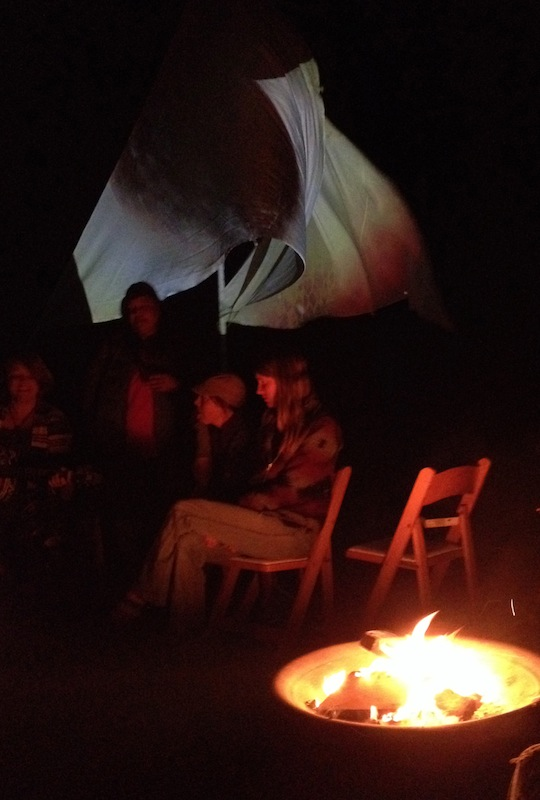 "Outside by the fire, with the ""sails"" moving in the breeze"