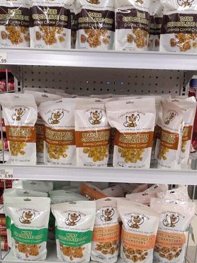 A store shelf displaying Crazy Monkey Baking Granola bags.