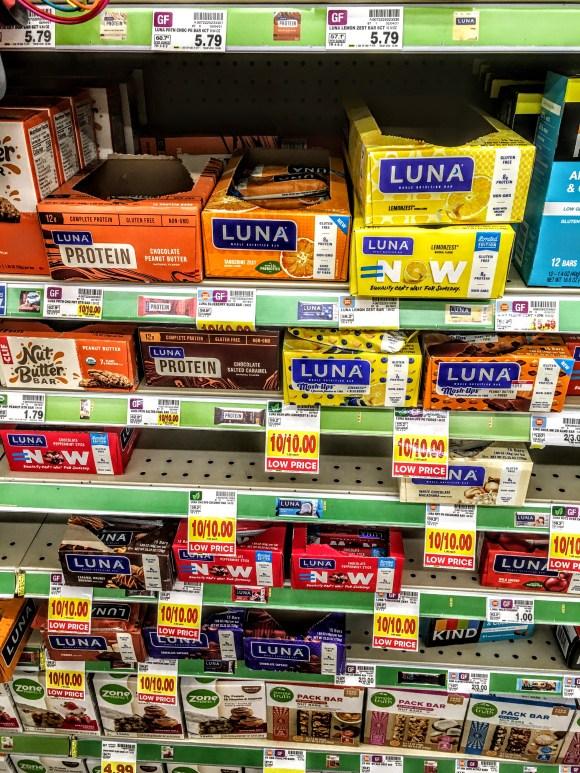 A store shelf displaying luna nutrition bars.