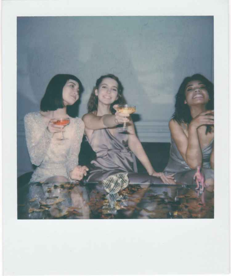 instant photo of three women drinking