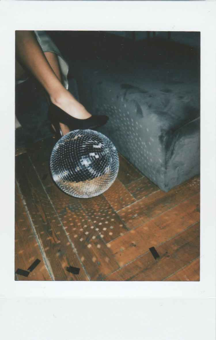 gray disco ball on brown wooden surface